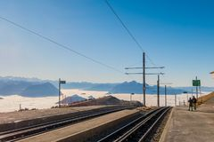 Utility poles and power lines supply electricity to cogwheel trains Stock Images