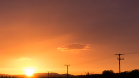 Utility poles sunset Stock Photo
