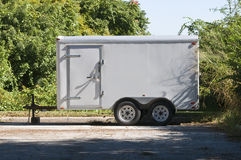 Utility Trailer. Parked Off White Utility Trailer waiting for pick up Royalty Free Stock Images