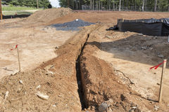 Utility trench on construction site Royalty Free Stock Photo