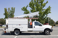 Utility Truck. Parked utility truck with three and blue sky royalty free stock image