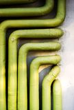 Utility tubes. Industrial plumbing tubes with green isolation Royalty Free Stock Images