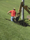Utility Work. Digging up a utility line stock photos