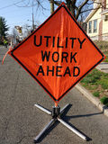 Utility Work Ahead with Worker and Equipment Stock Photo