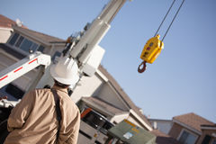 Utility Worker Navigating Remote Crane Royalty Free Stock Images