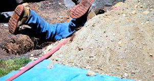 Utility worker underground. Royalty Free Stock Photography
