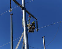 Utility Worker working on Power Poles Royalty Free Stock Images