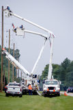 Utility Workers. A group of Utility Workers working on installing new telephone poles Stock Image