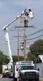 Utility workers. Doing maintenance on power pole Royalty Free Stock Images