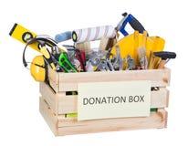 Utiliza ferramentas a caixa das doações fotografia de stock