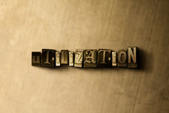 UTILIZATION - close-up of grungy vintage typeset word on metal backdrop Stock Image