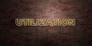 UTILIZATION - fluorescent Neon tube Sign on brickwork - Front view - 3D rendered royalty free stock picture. Can be used for online banner ads and direct Stock Image