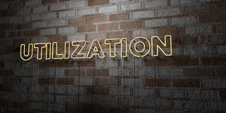 UTILIZATION - Glowing Neon Sign on stonework wall - 3D rendered royalty free stock illustration. Can be used for online banner ads and direct mailers Stock Photos