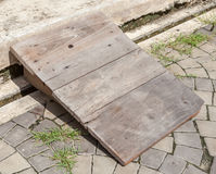 Utilization of wooden board for step or slide. On the Street Royalty Free Stock Image