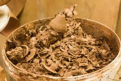 Utilized clay in a trash can. At the potter& x27;s workshop Stock Photos