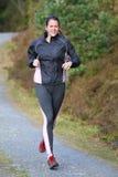 utomhus- running kvinnabarn Royaltyfri Bild