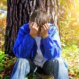 Utomhus- sorgsen tonåring Royaltyfri Foto