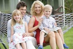 utomhus- stående för familj arkivbild