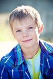Utomhus- stående för pojke Arkivbild