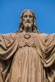 Utomhus- staty av Jesus Arkivbild