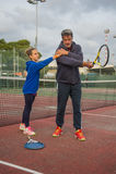Utomhus- tennisskola Arkivbild