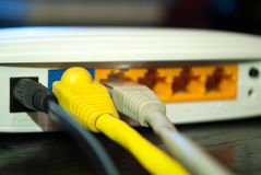 UTP Lan cables plugs in wifi router Stock Photo