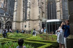 Tourists taking pictures in the Pandhof at the Dom Church in Utrecht Royalty Free Stock Image