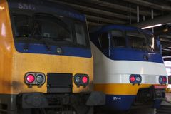 Utrecht, the Netherlands, February 15, 2019: Two trains from the dutch railway system: yellow intercity, white sprinter royalty free stock photos