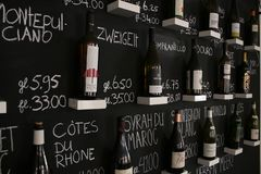 Utrecht, Netherlands - March 10, 2019: Wall with winebottles that are being sold in a wine bar stock photography