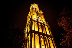 UTRECHT, NETHERLANDS - OCTOBER 18: Ancient European church with night-time lighting. Utrecht - Holland Royalty Free Stock Photography