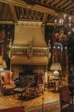 Opulent furniture and fireplace in De Haar Castle, near Utrecht. Utrecht, northern Netherlands - June 28, 2017. Opulent furniture and fireplace in De Haar Stock Photo