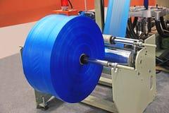 Utrustning för tillverkningplastpåsar Arkivfoton