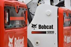 Utrustningmedel och logo för Bobcat tungt arkivbild