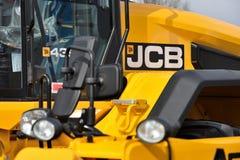 Utrustningmedel och logo för JCB tungt Arkivfoto