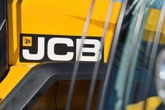 Utrustningmedel och logo för JCB tungt royaltyfri bild