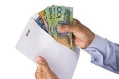 Utrzymywać dolara australijskiego pieniądze w kopercie Fotografia Royalty Free
