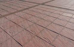 Utskrivaven utomhus- trottoar för konkret golv Royaltyfria Foton