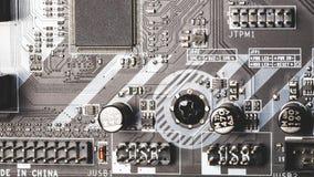Utskrivavet datormoderkort med microcircuiten, slut upp fotografering för bildbyråer