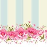 Utsmyckad rosa färgblommagräns med tegelplattan Royaltyfria Foton
