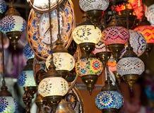 Utsmyckade glass lampor på marknadsstallen Fotografering för Bildbyråer