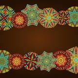 Utsmyckade Mandalas på den abstrakta ramen Arkivfoton