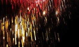 Utsmyckat abstrakt händelsefyrverkeriljus på svart bakgrund Arkivbild