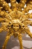Utsmyckat guld- hjulnav för en vagn arkivfoton