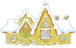 Utsmyckat journalhus under snö royaltyfri bild