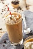 Utsmyckat med is kaffe med kräm royaltyfri foto