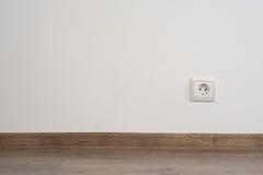 Uttag på väggen Arkivfoto