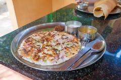 Uttapam, традиционный южный индийский завтрак Стоковые Изображения