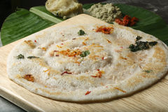 Uttapam is a dosa-like pancake from India. The batter to make Uttapam is made of urad dal and rice that has been fermented. Instead of making it like a crispy Royalty Free Stock Photos