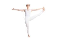 Utthita Hasta padangushthasana yoga pose. Sporty beautiful smiling young woman in white sportswear standing in Utthita Hasta padangustasana, Extended Hand-To-Big Stock Photo