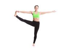 Utthita Hasta Padangustasana Yoga Pose. Athletic girl standing in yoga asana utthita hasta Padangustasana, extended hand to big toe yoga pose (stretched hand Stock Photos